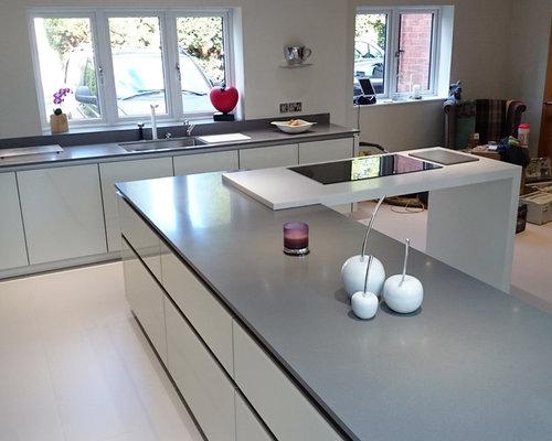 White Kitchen Grey Worktop krion worktop & island - grey and white combination