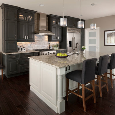 Inspiration for a large transitional galley dark wood floor kitchen remodel in Other with an undermount sink, raised-panel cabinets, gray cabinets, matchstick tile backsplash, stainless steel appliances, beige backsplash, an island and quartz countertops