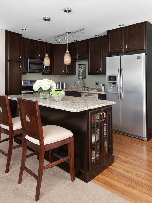 traditional l shaped eat in kitchen idea in detroit with recessed panel cabinets - Merillat Classic Kitchen Cabinets