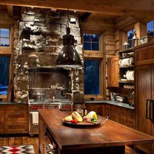 This is an example of a rustic kitchen in Atlanta with wood worktops, integrated appliances and metal splashback.