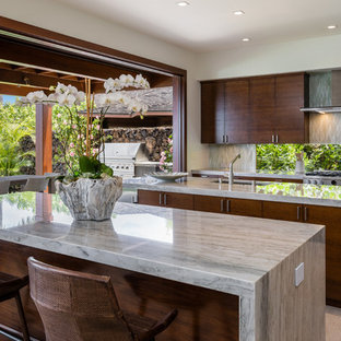 Tropical kitchen photos - Island style gray floor kitchen photo in Other with an undermount sink, flat-panel cabinets, dark wood cabinets, window backsplash, stainless steel appliances and two islands