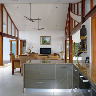 Inspiration for a mid-sized tropical u-shaped eat-in kitchen in Brisbane with flat-panel cabinets, granite benchtops and porcelain floors.