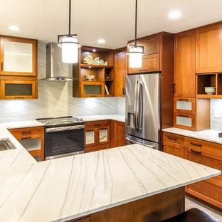 Esempio di una cucina moderna di medie dimensioni con lavello a vasca singola, ante con riquadro incassato, ante in legno scuro, top in quarzite, paraspruzzi bianco, paraspruzzi in lastra di pietra, elettrodomestici in acciaio inossidabile, pavimento in cementine, penisola, pavimento grigio e top bianco