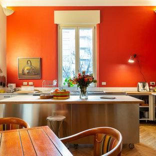 Inspiration pour une très grand cuisine bohème avec un sol en bois clair.