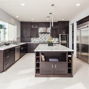 Inspiration for a mid-sized modern u-shaped kitchen in San Diego with an undermount sink, shaker cabinets, dark wood cabinets, marble benchtops, multi-coloured splashback, matchstick tile splashback, stainless steel appliances, porcelain floors and with island.