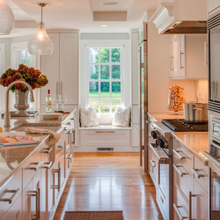 Beach style kitchen appliance - Example of a coastal kitchen design in Boston with shaker cabinets