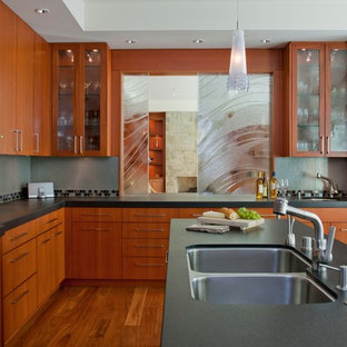 Contemporary u-shaped kitchen in San Diego with a double-bowl sink, flat-panel cabinets, multi-coloured splashback, medium wood cabinets, granite worktops, medium hardwood flooring and an island.