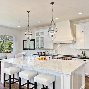 Large mediterranean eat-in kitchen appliance - Eat-in kitchen - large mediterranean galley medium tone wood floor eat-in kitchen idea in San Diego with a farmhouse sink, shaker cabinets, white cabinets, white backsplash, stainless steel appliances, an island and marble countertops