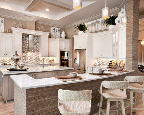 Inspiration For A Beach Style U Shaped Kitchen Remodel In Miami With Shaker  Cabinets,