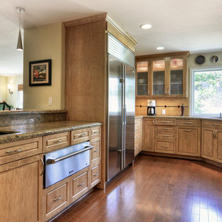 Large transitional l-shaped medium tone wood floor open concept kitchen photo in Los Angeles with an undermount sink, raised-panel cabinets, light wood cabinets, granite countertops, multicolored backsplash, ceramic backsplash, stainless steel appliances and a peninsula