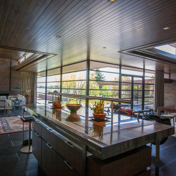 Lac La Belle - Modern Brick Lake Home Kitchen, Living Room and Dining Room with