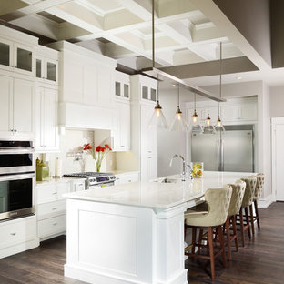 Large traditional open concept kitchen ideas - Open concept kitchen - large traditional u-shaped medium tone wood floor open concept kitchen idea in Other with an undermount sink, shaker cabinets, marble countertops, white backsplash, porcelain backsplash, stainless steel appliances, an island and white cabinets