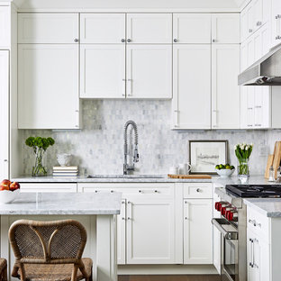 Mid-sized transitional kitchen photos - Kitchen - mid-sized transitional l-shaped kitchen idea in DC Metro with shaker cabinets, white cabinets, marble countertops, gray backsplash, marble backsplash, stainless steel appliances, an island, an undermount sink and gray countertops