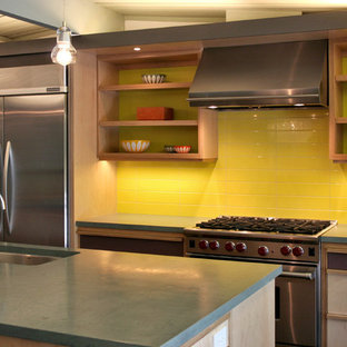 Design ideas for a midcentury eat-in kitchen in San Francisco with an undermount sink, recessed-panel cabinets, light wood cabinets, concrete benchtops, yellow splashback, ceramic splashback, stainless steel appliances, ceramic floors and with island.