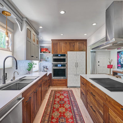 Eat-in kitchen - mid-sized contemporary l-shaped light wood floor and multicolored floor eat-in kitchen idea in Sacramento with an undermount sink, shaker cabinets, medium tone wood cabinets, quartz countertops, white backsplash, porcelain backsplash, stainless steel appliances, a peninsula and white countertops