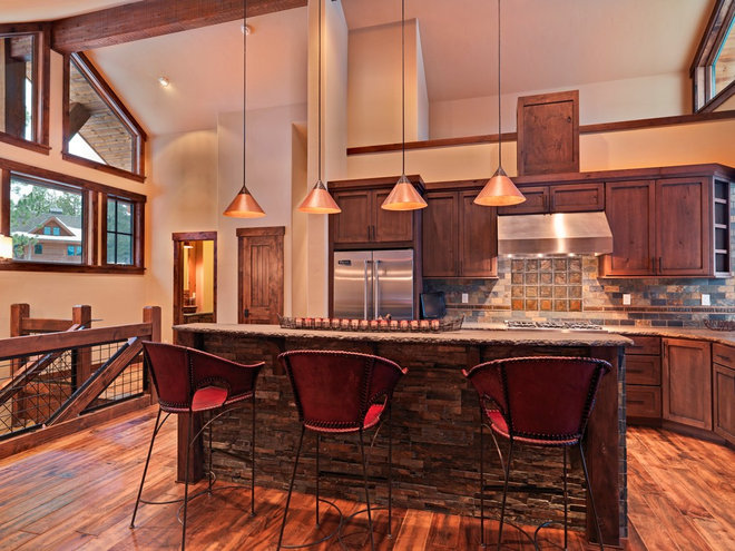 Rustic Kitchen by Griggs Custom Homes, Inc
