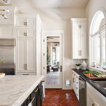 Lake Austin Kitchen with White Cabinets, Black Island