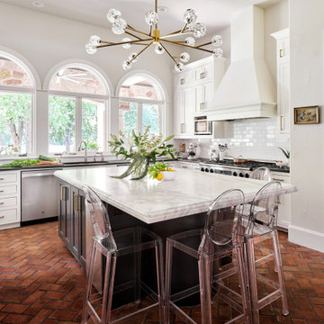 Lake Austin Kitchen with White Cabinets, Black Island