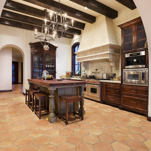 Inspiration for a rustic kitchen in Austin with stainless steel appliances.