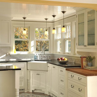 Traditional kitchen ideas - Example of a classic kitchen design in Minneapolis with subway tile backsplash, a farmhouse sink, beaded inset cabinets, white cabinets and white backsplash
