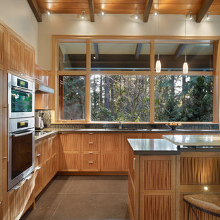 Inspiration for a mid-sized midcentury l-shaped eat-in kitchen in Seattle with recessed-panel cabinets, medium wood cabinets, an undermount sink, quartz benchtops and panelled appliances.