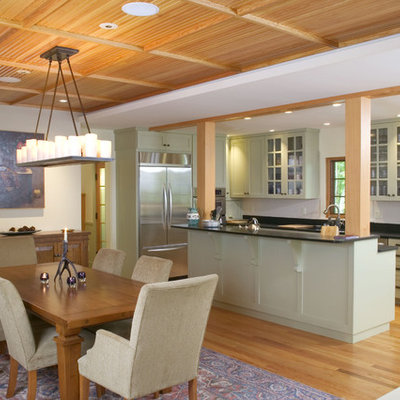Elegant galley eat-in kitchen photo in Boston with stainless steel appliances