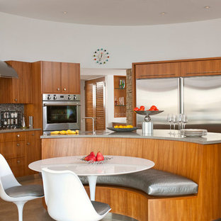 Design ideas for a mid-sized midcentury u-shaped eat-in kitchen in Dallas with flat-panel cabinets, medium wood cabinets, an undermount sink, grey splashback, stainless steel appliances, concrete floors, with island, concrete benchtops, mosaic tile splashback and grey floor.