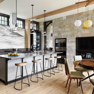 Trendy eat-in kitchen photo in Chicago with white backsplash