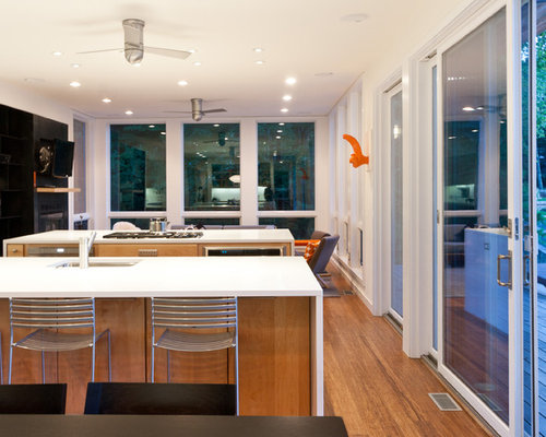 Example Of A Minimalist Open Concept Kitchen Design In New York With Quartz  Countertops