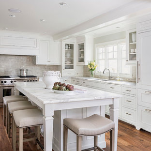 Mid-sized traditional kitchen pictures - Kitchen - mid-sized traditional l-shaped dark wood floor kitchen idea in Minneapolis with recessed-panel cabinets, subway tile backsplash, paneled appliances, white cabinets, marble countertops, gray backsplash, an undermount sink, an island and white countertops