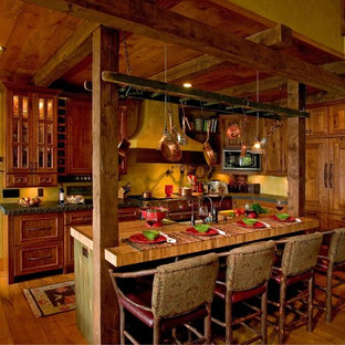 Inspiration for a rustic kitchen remodel in Minneapolis with wood countertops