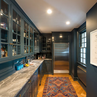 Large traditional eat-in kitchen pictures - Large elegant u-shaped light wood floor eat-in kitchen photo in Minneapolis with an undermount sink, raised-panel cabinets, blue cabinets, marble countertops, white backsplash, stone tile backsplash, paneled appliances and an island