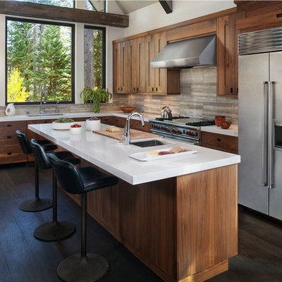 Mountain style kitchen photo in San Francisco with an undermount sink, flat-panel cabinets, beige backsplash, stainless steel appliances and medium tone wood cabinets