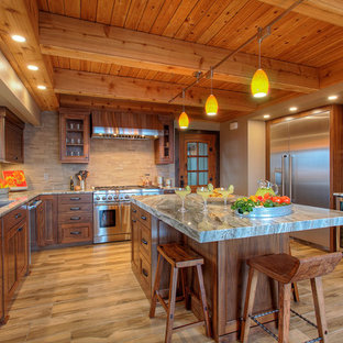 Rustic kitchen ideas - Mountain style u-shaped brown floor kitchen photo in Seattle with an undermount sink, medium tone wood cabinets, beige backsplash, stainless steel appliances, an island and multicolored countertops
