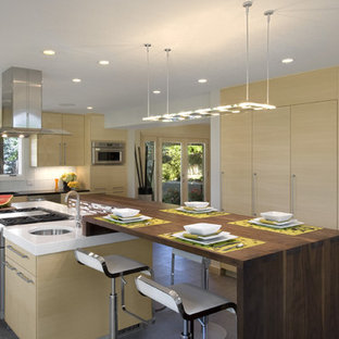 Inspiration for a modern kitchen remodel in Denver with stainless steel appliances and wood countertops