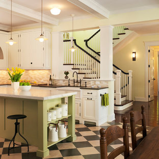 Beach style kitchen designs - Example of a coastal linoleum floor kitchen design in DC Metro with beige backsplash, white cabinets, recessed-panel cabinets and a farmhouse sink