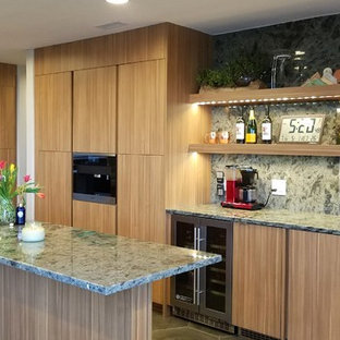 Inspiration for a mid-sized contemporary u-shaped eat-in kitchen with a double-bowl sink, medium wood cabinets, granite benchtops, green splashback, stone slab splashback, stainless steel appliances, porcelain floors, with island, grey floor and green benchtop.