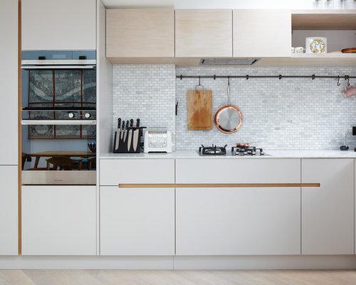 Kitchen ideas photos with beige splashback and an for Sink splashback ideas