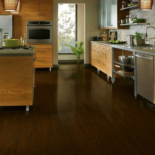 Inspiration for a huge modern u-shaped dark wood floor eat-in kitchen remodel in San Diego with a drop-in sink, shaker cabinets, light wood cabinets, concrete countertops, gray backsplash, ceramic backsplash, stainless steel appliances and an island