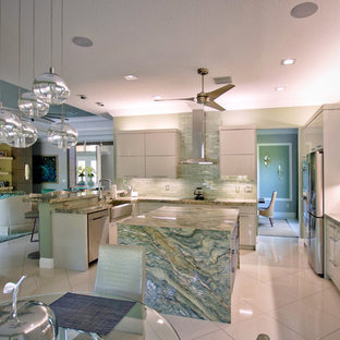 Inspiration for a large contemporary u-shaped open plan kitchen in Miami with a farmhouse sink, flat-panel cabinets, green cabinets, granite benchtops, green splashback, glass tile splashback, stainless steel appliances, marble floors, with island, white floor and green benchtop.