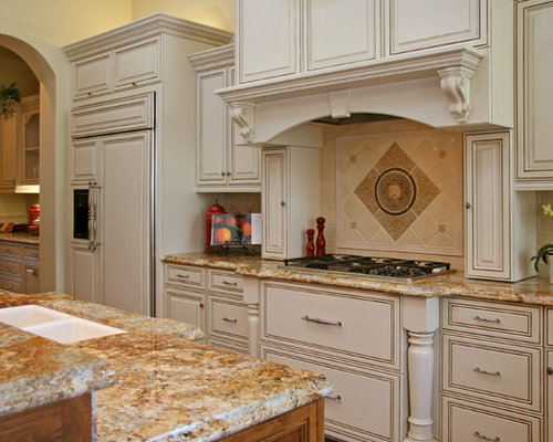 Example Of A Classic Kitchen Design In Sacramento With Granite Countertops  And Paneled Appliances