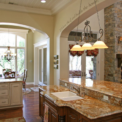 Inspiration for a timeless open concept kitchen remodel in Sacramento with a double-bowl sink, raised-panel cabinets and beige cabinets