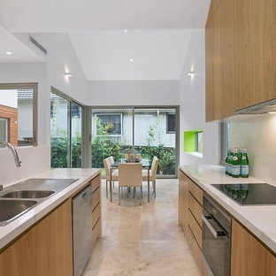Contemporary eat-in kitchen designs - Eat-in kitchen - contemporary u-shaped ceramic floor eat-in kitchen idea in Sydney with a double-bowl sink, raised-panel cabinets, brown cabinets, laminate countertops, white backsplash, glass sheet backsplash, black appliances and an island