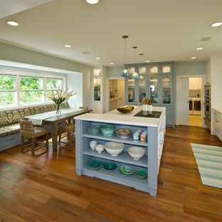 Design ideas for a tropical kitchen pantry in Hawaii with an integrated sink, shaker cabinets, white cabinets, solid surface benchtops, blue splashback, glass tile splashback, panelled appliances and with island.