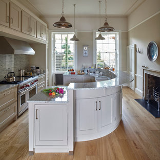 Inspiration for a large traditional galley kitchen/diner in Wiltshire with shaker cabinets, grey cabinets, granite worktops, stainless steel appliances, an island, grey splashback, a belfast sink, porcelain splashback and light hardwood flooring.