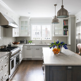 Mid-sized transitional open concept kitchen designs - Open concept kitchen - mid-sized transitional l-shaped dark wood floor open concept kitchen idea in New York with an undermount sink, shaker cabinets, white cabinets, quartzite countertops, gray backsplash, ceramic backsplash, stainless steel appliances and an island