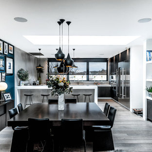 Inspiration for a contemporary open plan kitchen in Other with a double-bowl sink, flat-panel cabinets, dark wood cabinets, ceramic splashback, stainless steel appliances, dark hardwood flooring and white worktops.