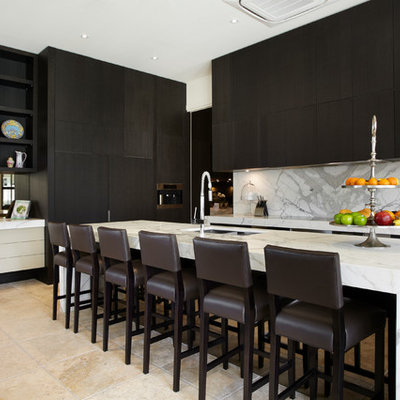 Inspiration for a contemporary travertine floor kitchen remodel in Melbourne with flat-panel cabinets, marble countertops, white backsplash and marble backsplash