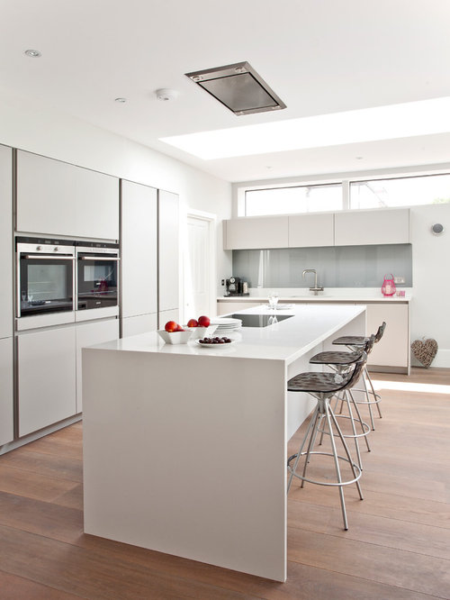 Inspiration For A Contemporary L Shaped Medium Tone Wood Floor Kitchen  Remodel In Surrey With