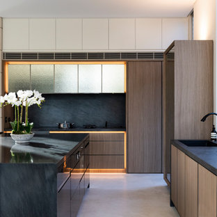 Large contemporary l-shaped kitchen in Sydney with flat-panel cabinets, medium wood cabinets, quartz benchtops, black splashback, marble splashback, stainless steel appliances, ceramic floors, with island, white floor, black benchtop and an undermount sink.